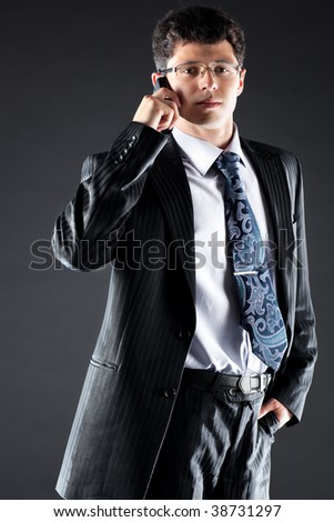 Young businessman. On dark background. - stock photo