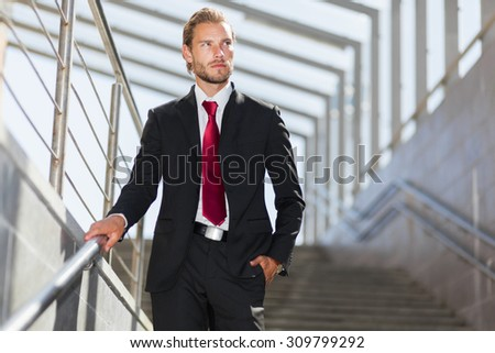 Young businessman on the stairs in an urban setting