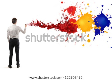 Young businessman painting a wall - stock photo