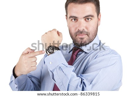 young businessman pointing at his watch over white background - stock photo