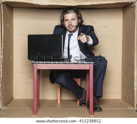 young businessman pointing at you, office situation, - stock photo