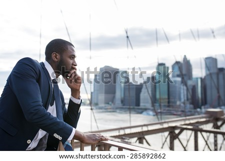 Young businessman portrait on Brooklyn Bridge. New York City. - stock photo