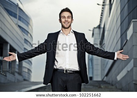 Young businessman pose outdoor. - stock photo