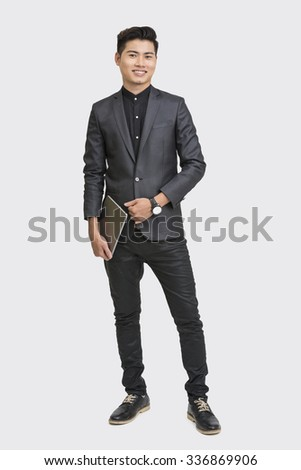 Young businessman posing with digital tablet  - stock photo