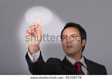 young businessman pressing email button