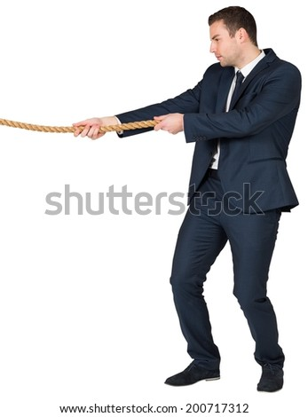Young businessman pulling a rope on white background