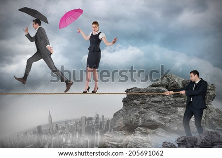 Young businessman pulling a tightrope for business people against rocky landscape - stock photo
