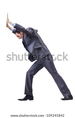 Young businessman pushing invisible obstacles - stock photo
