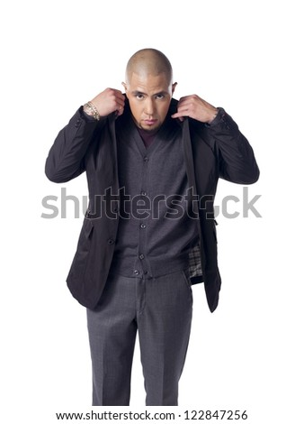 Young businessman putting on his suit over a background - stock photo