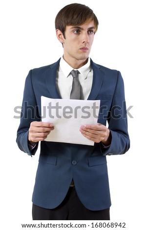 young businessman reading a presentation / press announcement - stock photo