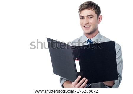 Young businessman reading documents inside a folder - stock photo