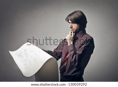 young businessman reading papyrus