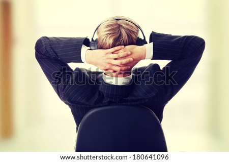 Young businessman relax with music - stock photo