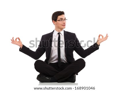 Young businessman relaxing. Full length studio shot isolated on white. - stock photo