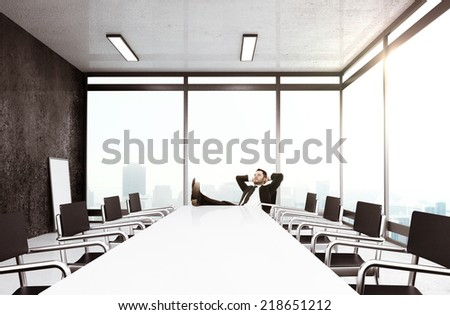 young businessman relaxing in office - stock photo