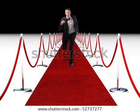 young businessman running on red carpet - stock photo