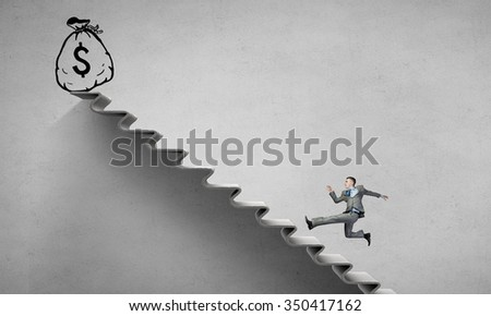 Young businessman running up on staircase representing success concept - stock photo