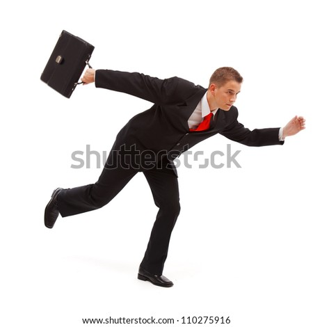 Young businessman running with case