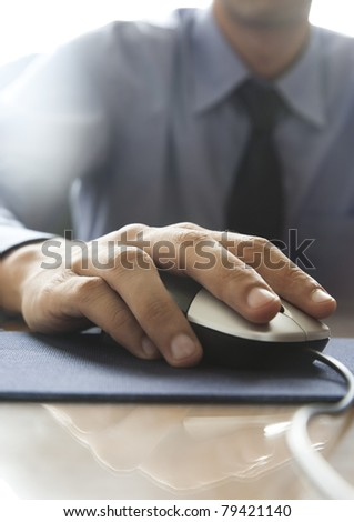 young businessman's hand on mouse - stock photo