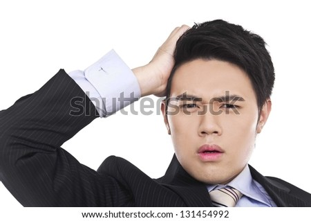 young businessman scratching his head, hard decision, - stock photo