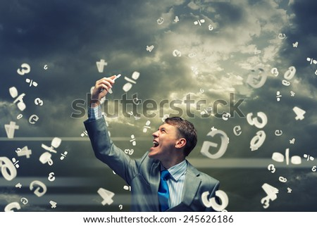 Young businessman screaming furiously in mobile phone - stock photo