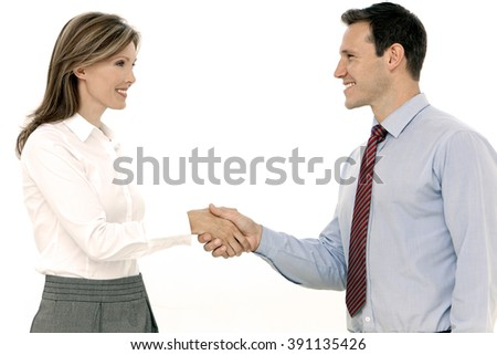 Young Businessman shaking hands of a business female manager - white background - stock photo