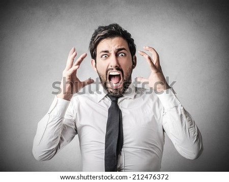 young businessman shouting - stock photo
