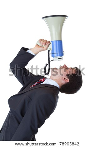 Young businessman shouts loudly into megaphone overhead.Isolated on white background. - stock photo