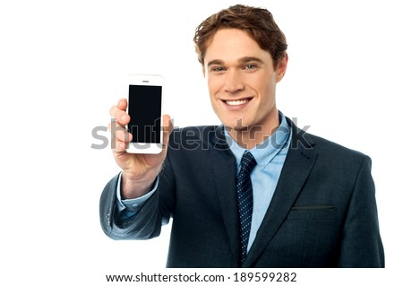Young businessman showing his smart phone - stock photo