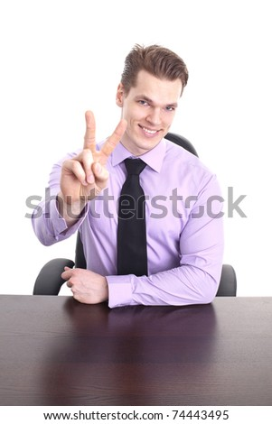Young businessman showing victory sign, isolated on white background