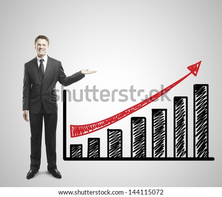 young businessman shows arrow graph