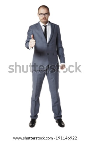 Young businessman shows ok sign. Thumbs up - stock photo