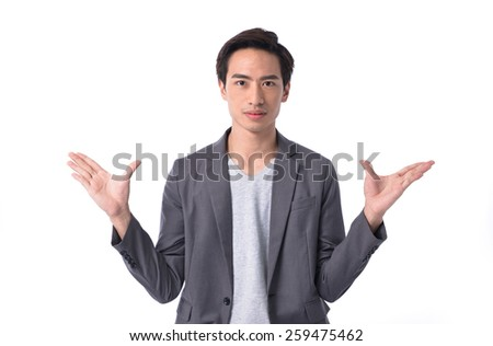 Young businessman shrugging - stock photo