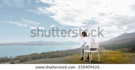 Young businessman sitting in chair and relaxing