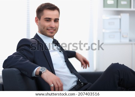 young businessman sitting in his office