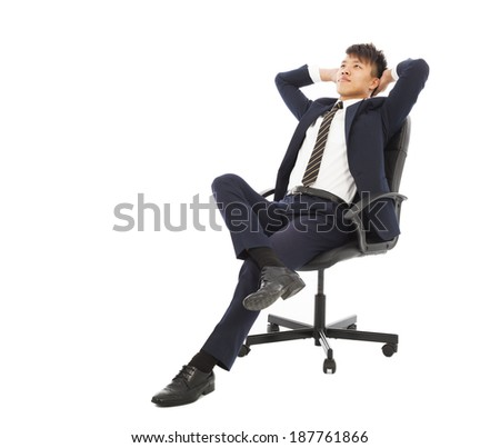 young businessman sitting on a chair and thinking  - stock photo