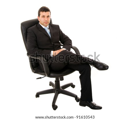 young businessman sitting on office chair against white background - stock photo