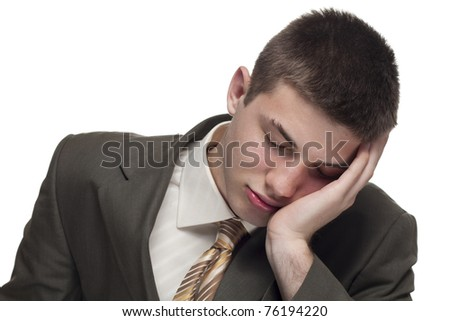 Young businessman sleeps at work - stock photo