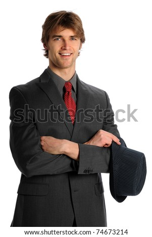 Young businessman smiling and holding hat isolated over white background - stock photo