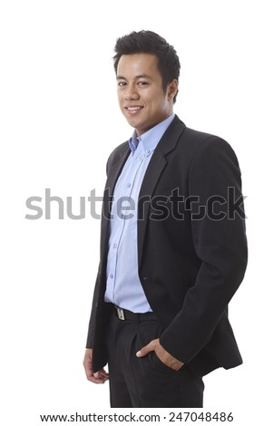 Young businessman smiling with hand in pocket. - stock photo