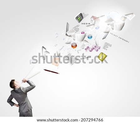Young businessman speaking in trumpet and colorful icons flying out - stock photo