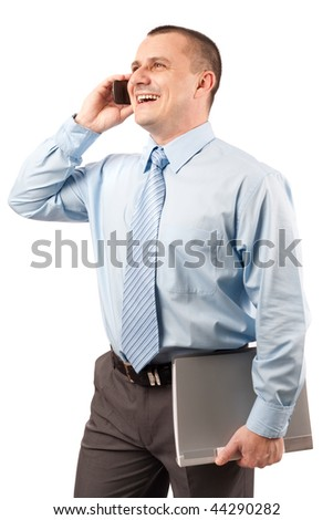 Young businessman speaking on mobile phone, holding a folder - stock photo