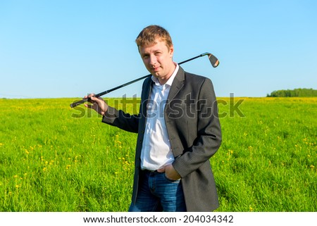 young businessman spends his free time playing golf - stock photo