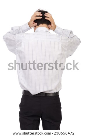 Young businessman standing back holding hands on head isolated over white background