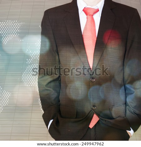 Young businessman standing in front of background