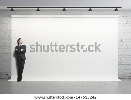 young businessman standing in studio - stock photo