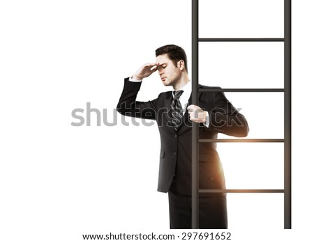 young businessman standing on ladder and looking - stock photo