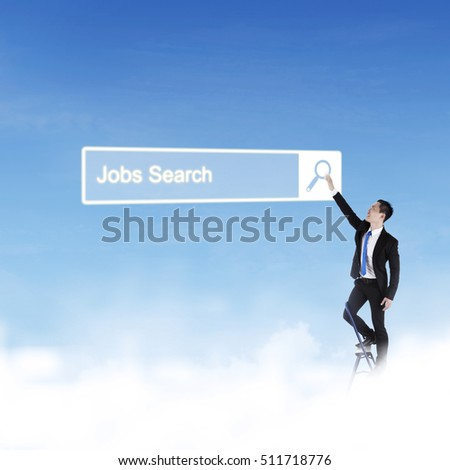 Young businessman standing on the stairs and search jobs online in the search bar on the virtual screen at blue sky