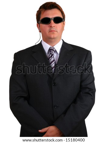 Young businessman suggesting a secret service agent - stock photo