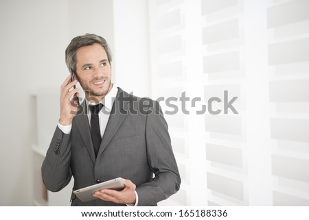 young businessman surfing on tablet